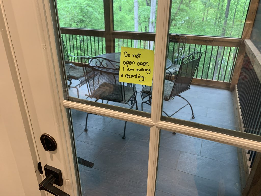 "Post-it note on door: An attempt to communicate: ""Do not open door. I am making a recording."""
