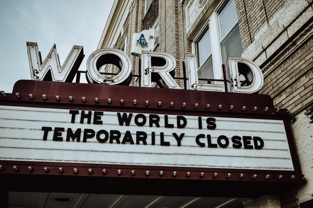 Movie theater (The World) marquee that reads, The World Is Temporarily Closed.