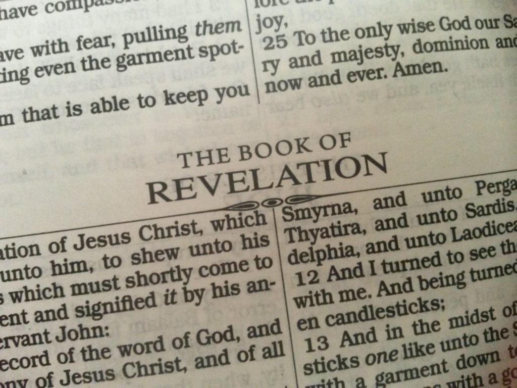 Page one of the KJV version of the book of Revelation. Before we read the first word, we bring assumptions to the text.  Image by James Nichols from Pixabay.